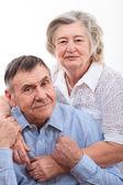 高齢者のカップルを笑顔のクローズ アップの肖像画 — ストック写真
