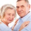 Portrait of smiling elderly couple — Stock Photo