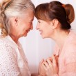 Seniors woman with her caregiver at home — Stock Photo