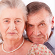 Closeup portrait of smiling elderly couple - 