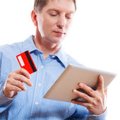 Portrait of young man holding tablet — Stock Photo