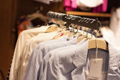 Clothes in the modern retail store — Stock Photo