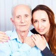 Stock Photo: Senior mwith her caregiver at home