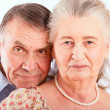 Closeup portrait of smiling elderly couple - Stock Photo