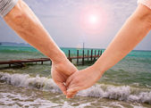 Happy couple holding hands — Stock Photo