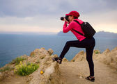 Tourist with backpacks taking photo landshape — Stock Photo