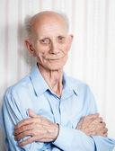 Portrait senior with arms crossed — Stock Photo