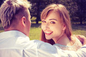 Beautiful girl embraces the guy — Stock Photo