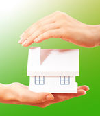 The house in human hands — Stock Photo