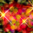 Multi-colored glowing background. Christmas card. — Stock Photo #33557393