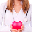 Female doctor holding a heart. — Stock Photo