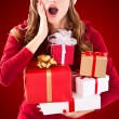 Woman in Santa Claus with gift — Stock Photo