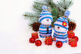 Cheerful family of snowmen — Stock Photo