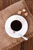 Coffee cup and saucer on wooden table. — Foto Stock