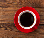 Coffee cup and saucer on wooden table. — Stock Photo