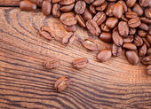 Coffee beans on wood texture — Stock Photo