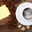 Stock Photo: Coffee cup and saucer on wooden table.