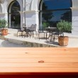 Empty wooden deck table in cafe — Stock Photo