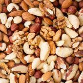 Hazelnuts, filbert on old wooden background — Stock Photo