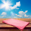 Empty wooden deck table with tablecloth — Stock Photo #37271291