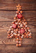 Hazelnuts, filbert on old wooden background — Stock Photo