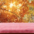 Empty wooden deck table with tablecloth — Stock Photo