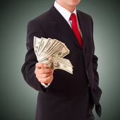 Business man holding cash dollars — Stock Photo