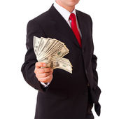 Businessman holding Cash Dollars in hands — Stock Photo