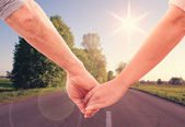 Happy couple holding hands close up — Stock Photo