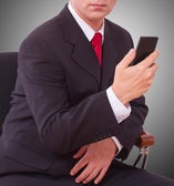 Businessman talking on the phone in office — Stock Photo