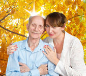 Senior Man, Woman with their Caregiver at Home. — Stock Photo
