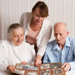 Stock Photo: Senior Man, Womwith their Caregiver at Home.