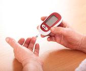 Woman makes testing high blood sugar. — Stock Photo