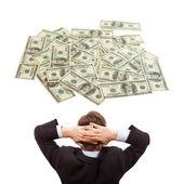 Podnikatel sní o peníze — Stock fotografie