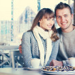 Family is drinking coffee in cafe — Stock Photo #40558473