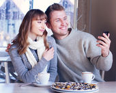 Man and Woman in cafe — Stock Photo