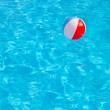Inflatable colorful ball floating in swimming pool — Stock Photo #41129477