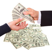 Businessman giving money cash dollars in the hands — Stock Photo