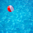 Inflatable colorful ball floating in swimming pool — Stock Photo