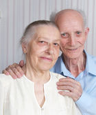 Closeup portrait of smiling elderly couple — Stok fotoğraf