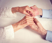 Happy elderly couple. Old people holding hands. — Stock Photo
