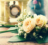 Bridal bouquet of white flowers on wooden surface. — Stock Photo