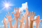 Raised up hands of many people — Stock Photo