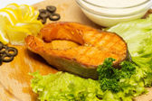 Fried steak from a salmon on a wooden dish. — Stock Photo