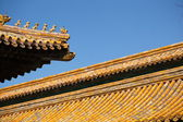 Figures of animals on the roof of the Forbidden City in Beijing — Stock Photo