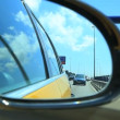 Sooting the road through the side mirror of a car in Barcelona — Stock Video