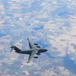 Military airplane in flight — Stock Photo #11784087
