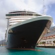 Nose of the big ocean liner against island — Stock Photo #11852256