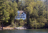 Home by a lake — Stock Photo