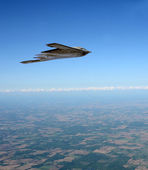 Stealth bomber in flight — Stock Photo